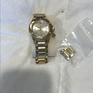 "Juicy Couture ""Rich Girl"" gold faced watch"